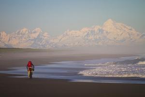 A Man Teasdale Fatbiking On A Remote Beach Near Yakutat, Alaska by Ryan Krueger