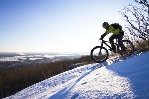 Fatbiking On A Trail In Winter In Duluth, Minnesota by Ryan Krueger