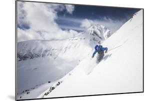 Male Skier Above The Pinnacles With Lone Peak In The Background Big Sky Resort, Montana by Ryan Krueger
