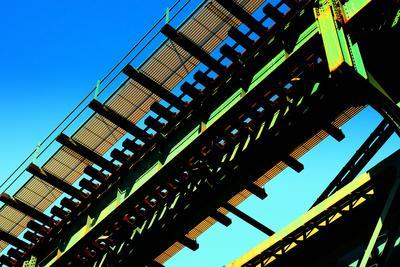 Rusty Subway Bridge Against Blue Sky from a Low Angle, Bronx, Ne