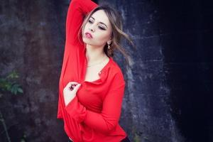 Young Woman Wearing Red Blouse by Sabine Rosch