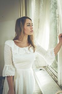Young Woman Wearing White Dress by Sabine Rosch