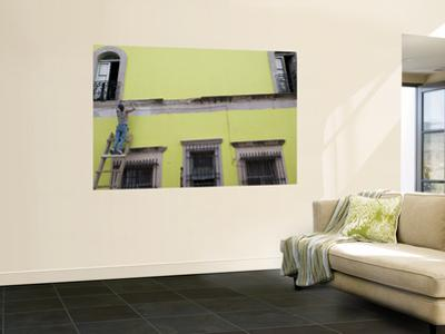 Painter Restoring Building