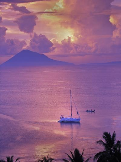 Sailboat Anchored in the Pacific Ocean at Sunset Off the Manado Coast-Greg Dale-Photographic Print