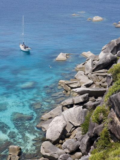 Sailboat and Snorkelers Near Granite Rocks-Holger Leue-Photographic Print