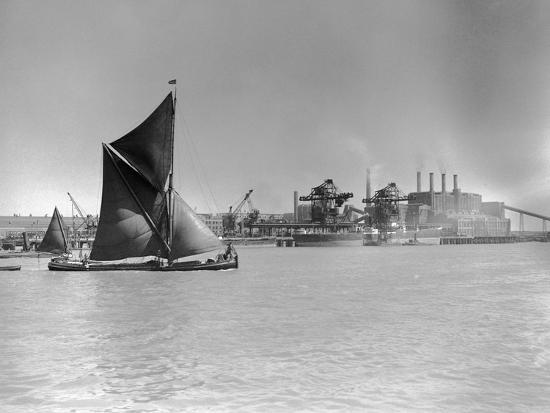 Sailboat Passes Ford Motor Works--Photographic Print