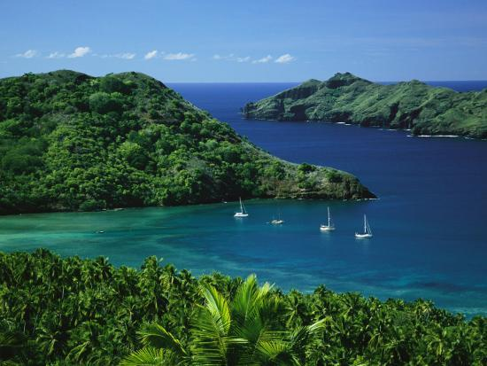 Sailboats Anchored in a Cove of Blue Water on an Asian Island-Tim Laman-Photographic Print