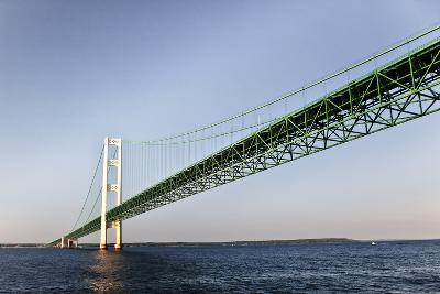 Sailing under the Mackinac Bridge in Mackinac Island, Michigan, USA-Joe Restuccia III-Photographic Print