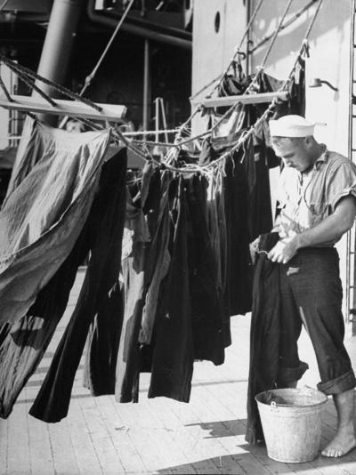 Sailor Aboard a Us Navy Cruiser at Sea Hanging Up Laundered Dungarees During WWII-Ralph Morse-Photographic Print