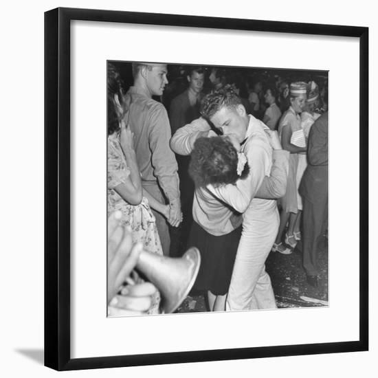 Sailor Kissing Pretty Girl amidst Jubilant Crowd in Celebration Regarding the End of WWII-Gordon Coster-Framed Photographic Print