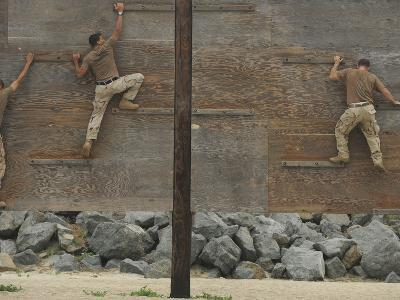 Sailors Crawl Across Narrow Planks of Wood As Part of An Obstacle Course-Stocktrek Images-Photographic Print