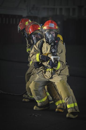 Sailors Practice Firefighting in the Hangar Bay of USS Nimitz--Photographic Print