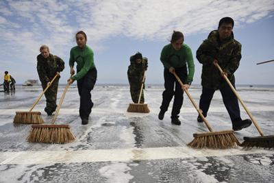 Sailors Scrub the Flight Deck of Aircraft Carrier USS Ronald Reagan