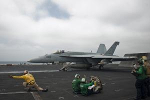 Sailors Signal to Launch an F-A-18E Super Hornet