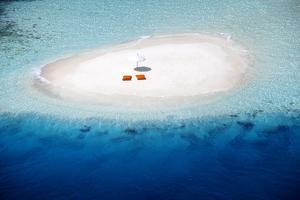 Aerial view of a sandbank, pillows and sun umbrella , Maldives, Indian Ocean, Asia by Sakis Papadopoulos