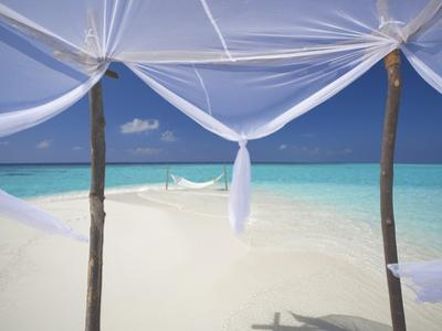 Hammock Hanging in Shallow Clear Water, the Maldives, Indian Ocean, Asia by Sakis Papadopoulos