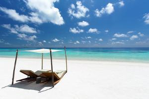 Lounge chairs on tropical white sandy beach, The Maldives, Indian Ocean, Asia by Sakis Papadopoulos