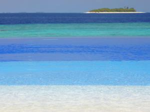 Swimming Pool and Tropical Island, Maldives, Indian Ocean, Asia by Sakis Papadopoulos