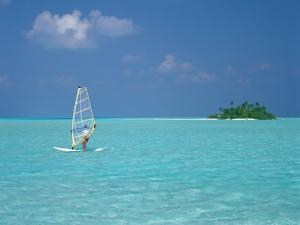 Young Man Windsurfing Near Tropical Island and Lagoon in the Maldives, Indian Ocean by Sakis Papadopoulos