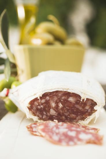 Salami and Green Olives on Table Out of Doors-Foodcollection-Photographic Print