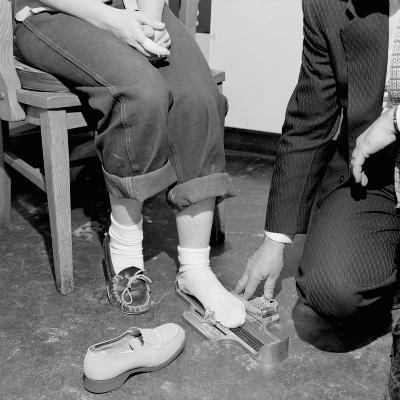 Salesmen Helps Woman with Safety Work Shoes, Ca. 1943--Photographic Print