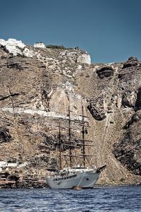 Saliboat Under the Caldera in Santorini Greece