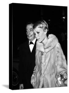 """Salvador Dali and Mia Farrow at the Premiere of the Film """"The Night of the Generals"""", Paris"""