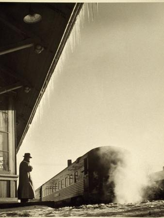 A man awaits the Lake Shore Limited train. by Sam Abell