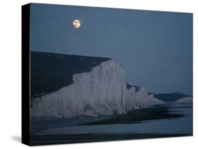 A Midsummer Moon Hangs over Chalk Cliffs