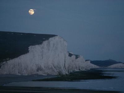 A Midsummer Moon Hangs over Chalk Cliffs