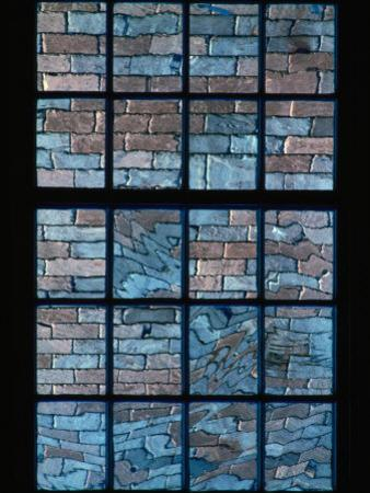 A Window Looks out Upon a Colorful Brick Wall
