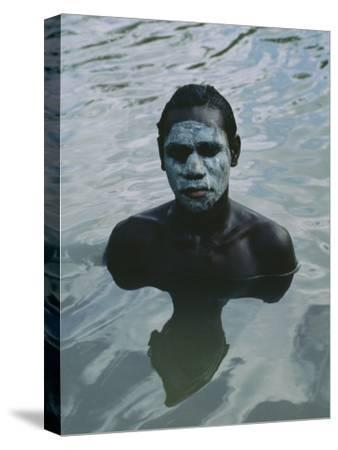 Aboriginal Teen with a Mask of Mud, Swimming in a Billabong