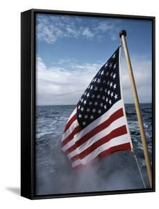 An American Flag Flutters from the Back of a Boat in Neah Bay by Sam Abell