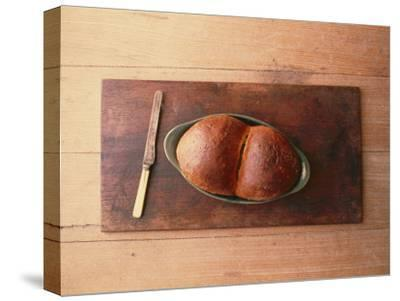 Bread Laid out on a Simple Table Setting