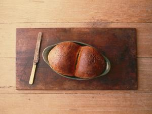 Bread Laid out on a Simple Table Setting by Sam Abell
