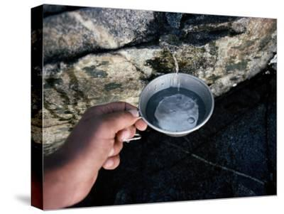 Hiker Getting a Cool Cup of Water