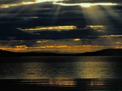 The Sun Sets over the Water in Tasmania by Sam Abell