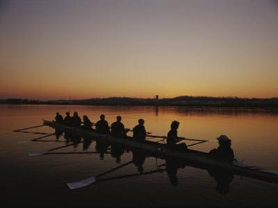 A Crew Team Prepares for Practice at Dawn