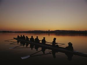 A Crew Team Prepares for Practice at Dawn by Sam Kittner