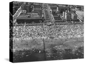 Aerial View of Crowds Enjoying a Hot 4th of July at Rockaway Beach by Sam Shere