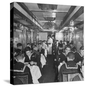 G.I. Personnel and Their Wives Eating in Dining Car While Civilians Will Have to Wait Until Later by Sam Shere
