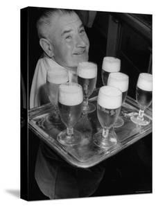 Glasses of Beer Being Served Onboard Oceanliner by Sam Shere