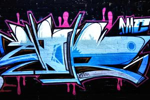 A Smart Graffiti Tag On A Brick Wall by sammyc