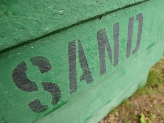 Sand Painted on Bright Green Wood Plank Wall--Photographic Print
