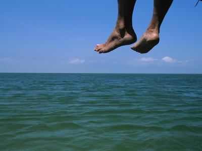 Sandy Feet Dangle Off the Side of a Dock on Portsmouth Island-Stephen Alvarez-Photographic Print