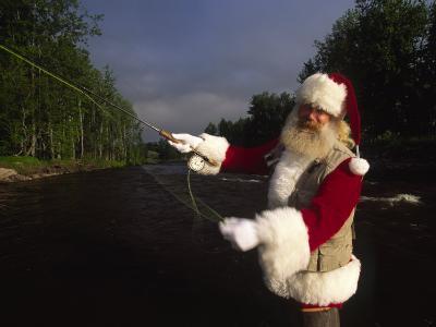 Santa Claus Fly Fishing-Michael Melford-Photographic Print