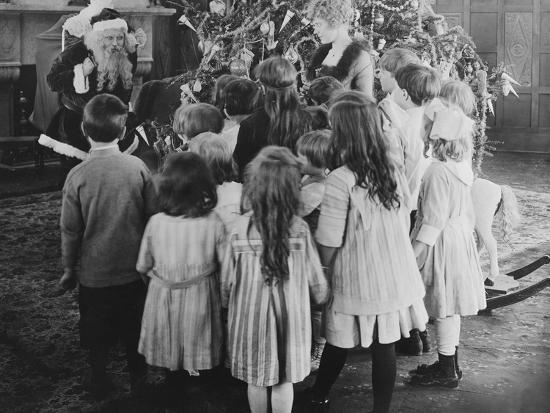 Santa Claus Visiting with Large Group of Children--Photo