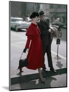 Glamour - September 1956 - Couple Stepping off of a Curb by Sante Forlano