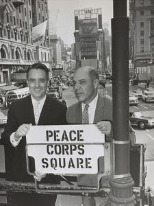 Sargent Shriver and Edward R. Dudley in Times Square with a Sign 'Peace Corps Square'