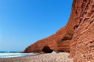 Natural Sea-Worn Rock Archways Against Clear Blue Sky at Legzira Beach, Morocco by Sarosa